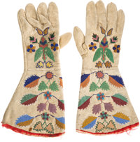 "William F. ""Doc"" Carver: A Colorful Pair of Beaded Buckskin Gauntlets Worn By Him in His Performing Days"