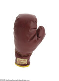 Boxing Collectibles:Autographs, 1960's Sugar Ray Robinson Signed Boxing Glove. The perfect venuefor the strong 8/10 black marker signature of the greatest...