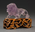 Asian:Chinese, A Chinese Carved Amethyst Rock Crystal Lion on Hardwood Base. 2 x3-1/2 x 1-1/8 inches (5.1 x 8.9 x 2.9 cm) (lion, excluding...(Total: 2 Items)
