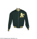 Baseball Collectibles:Uniforms, Circa 1992 Dennis Eckersley Game Worn Warm-Up Jacket. Unmistakable green and yellow jacket once kept the Hall of Fame reliev...