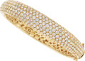 Estate Jewelry:Bracelets, Diamond, Gold Bracelet  The hinged bangle feat...