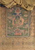 Asian:Chinese, A Tibetan Thangka Depicting Green Tara, 18th-19th century. 34inches high x 24 inches wide (86.4 x 61.0 cm) (work with texti...