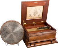 A Mahogany Regina Music Box with Seventeen Discs, early 20th century 10-1/4 x 22 x 20 inches (26.0 x 55.9 x 50.8 c
