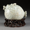 Asian:Chinese, A Chinese Ge-Type Porcelain Pomegranate on Hardwood Stand. 3-1/2 hx 5-1/8 w x 3-7/8 d inches (8.9 x 13.0 x 9.8 cm) (excludi...(Total: 2 Items)