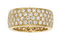 Estate Jewelry:Rings, Diamond, Gold Eternity Band  The eternity band...