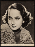 "Movie Posters:Miscellaneous, Merle Oberon Lot (c. 1930s-1940s). Autographed Card (4.25"" X 3.75"")& Newspaper Cutout (6.5"" X 8.75""). Miscellaneous.. ... (Total:2 Items)"