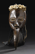 African: , Dan or Mau (Côte d'Ivoire). Face Mask. Wood, cloth, cowry shells, aluminum. Height: 15 inches Width: 5 ¾ inches Depth: 4 i...