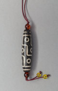 Asian:Chinese, A Tibetan Black Dzi Bead. 2-1/4 inches long (5.7 cm) (bead). ...