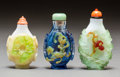 Asian:Chinese, Three Chinese Overlay Glass Snuff Bottles. 2-1/2 inches high (6.4cm). PROPERTY FROM A BEVERLY HILLS ESTATE... (Total: 3 Items)