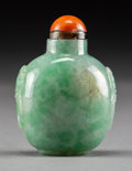 Asian:Chinese, A Chinese Carved Jadeite Snuff Bottle. 2-1/2 inches high (6.4 cm)....