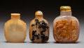 Asian:Chinese, Three Chinese Carved Agate Snuff Bottles, Qing Dynasty. 2-7/8inches high (7.3 cm) (tallest). PROPERTY FROM A BEVERLY HILL...(Total: 3 Items)