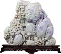 Asian:Chinese, An Exceptionally Large Carved Jadeite Boulder Group on HardwoodStand, 20th century. 17-1/2 h x 19-1/2 w x 3-1/2 d ...