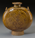 Asian:Chinese, A Chinese Brown-Glazed Pottery Moon Flask with Incised Decoration,Yuan Dynasty, circa 1271-1368. 9-3/8 inches high x 8-3/4 ...