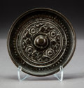 Asian:Chinese, A Chinese Bronze Hand Mirror, Tang Dynasty, circa 618-907. 3-1/2inches diameter (8.9 cm). ...