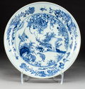 Asian:Chinese, A Chinese Blue and White Porcelain Dish with Quail and LandscapeMotif, Qing Dynasty, 18th-19th century