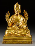 Asian:Chinese, A Sino-Tibetan Seated Bronze Lama Figure with Sanskrit Inscription,18th-19th century. 6-3/4 h x 5-1/8 w x 3-5/8 d inches (1...