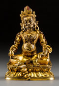 Asian:Chinese, A Sino-Tibetan Gilt Bronze Seated Jambhala Figure, Qing Dynasty,19th century. 6-1/2 h x 4-3/8 w x 3-5/8 d inches (16.5 x 11...
