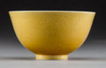 Asian:Chinese, A Chinese Yellow Glazed Porcelain Bowl with Incised Dragon Motif,Qing Dynasty, Jiaqing Period, circa 1796-1820. Marks: Six-...