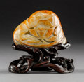 Asian:Chinese, A Chinese Carved Jade Lotus-Form Boulder on Hardwood Stand, QingDynasty. 2-1/2 h x 3-1/2 w x 1 d inches (6.4 x 8.9 x 2.5 cm...