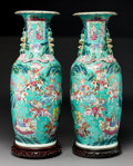 Asian:Chinese, A Pair of Chinese Enameled Porcelain Famille Rose Vases on HardwoodStands, Qing Dynasty. 24-7/8 inches high (63.2 cm) (vase... (Total:2 Items)