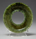 Asian:Chinese, A Chinese Carved Spinach Jade Candle Holder. 1-1/8 x 3-3/4 inches(2.9 x 9.5 cm). ...