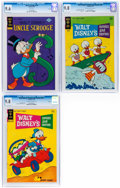 Bronze Age (1970-1979):Cartoon Character, Walt Disney's Comics and Stories #359 and 397 and Uncle Scrooge #136 CGC-Graded File Copies Group (Gold Key, 1970-77).... (Total: 3 Comic Books)