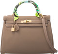 Luxury Accessories:Bags, Hermes 32cm Etoupe Togo Leather Retourne Kelly Bag with Gold Hardware & Green Twilly Scarf. Q Square, 2013. Condition:...