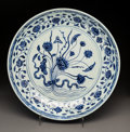 Asian:Chinese, A Large Chinese Blue and White Porcelain Dish, Ming Dynasty, YonglePeriod, circa 1403-1424. 2 inches high x 15 inches diame...