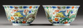Asian:Chinese, A Pair of Chinese Doucai Porcelain Cups with Dragon and PhoenixMotif. Marks: Six-character Kangxi mark. 2-1/8 inches high x...(Total: 2 Items)
