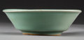 Asian:Chinese, A Chinese Celadon Glazed Earthenware Bowl, Song Dynasty, circa1127-1279. 1-1/2 inches high x 4-3/4 inches diameter (3.8 x 1...