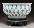 Asian:Chinese, A Chinese Blue and White Porcelain Fishbowl Planter on Hardwood Stand, 20th century. 7-5/8 x 16-1/4 inches (19.4 x 41.3 cm) ... (Total: 2 Items)