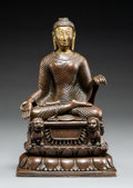 Asian:Chinese, A Silver-Inlaid Bronze Figure of a Seated Shakyamuni Buddha onThrone, 18th century or earlier, executed in the Swat ...