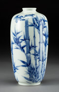 Asian:Japanese, A Japanese Blue and White Arita Porcelain Vase with Bamboo andSparrow Motif. Marks: Four-character mark. 10 inches high (25...
