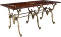 Furniture , A Country French Decorated Table on Cast Iron Base with Bull Motifs. 30-1/2 x 70 x 31-1/4 inches (77.5 x 177.8 x 79.4 cm). ...