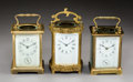Decorative Arts, French:Other , Three French Brass and Beveled Glass Carriage Clocks with EnameledPorcelain Faces, early 20th century . Marks: (various). 5...(Total: 3 Items)