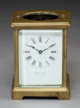 A French Brass and Beveled Glass Carriage Clock with Enameled Porcelain Face Retailed by Shreve & Co., San Franc...