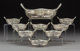 A Nine-Piece Gorham Silver Nut Dish Set, Providence, Rhode Island, circa 1930 Marks to large bowl: (lion-anchor-G), STER...
