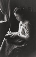 Photographs:Gelatin Silver, Gisèle Freund (German, 1912-2000). Simone de Beauvoir, the day of the Prix Goncourt, next to a window writing, Paris, 19...