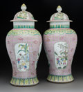 Asian:Chinese, A Pair of Chinese Enameled Porcelain Covered Jars, 20th century.Marks: Six-character Kangxi mark but of a later pe...