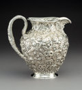 Silver & Vertu:Hollowware, An S. Kirk & Son Silver Floral Repoussé Pitcher with Mask Spout, Baltimore, Maryland, circa 1896-1924. Marks: S KIRK & SON...