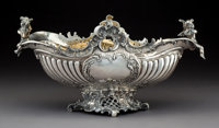 A Ludwig Neresheimer & Co. German Silver Figural Centerpiece, Hanau, late 19th century Marks: (pseudo marks); (lio...