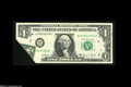 Error Notes:Foldovers, Fr. 1907-B $1 1969-D Federal Reserve Note. Gem Crisp Uncirculated.The lower right corner is folded over so that a portion o...