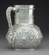 A Tiffany & Co. Silver Water Pitcher, New York, 1873-1891 Marks: TIFFANY & CO, 1511 MAKERS 6494. STERLING-SILVE...