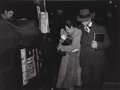 Photographs:Gelatin Silver, Lou Stoumen (American, 1917-1991). Rich Man - Poor Man, Times Square, New York; Young Couple, Times Square, New York , 1... (Total: 2 Items)
