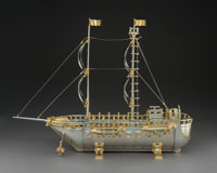 A Yossi Swed Partial Gilt Silver Ship-Form Menorah with Display Case, 1992-1993 Marks: (S over D monogram), (D but