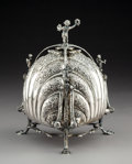 Silver & Vertu:Hollowware, A German Partial Gilt Silver Biscuit Warmer with Figural Finials, late 19th century . Marks: 800, (crescent-crown). 9 x ...