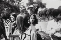"Garry Winogrand (American, 1928-1984) Woman in Group with Headband and Hoop Earrings in Park, from ""Women are B"