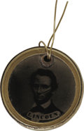 Political:Ferrotypes / Photo Badges (pre-1896), Abraham Lincoln: A Rare Ferrotype With Unlisted Portrait. While itis more common to encounter variations in brass frames an...