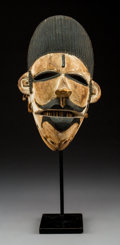 Tribal Art, An Ogoni Mask with Articulated Lower Jaw...