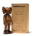 Sculpture, KAWS (b. 1974). Companion Karimoku Version, 2011. Karimoku wood. 10-1/2 x 4-1/2 x 3-1/4 inches (26.7 x 11.4 x 8.3 cm) (t...